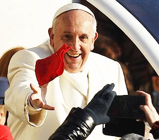 Pope Francis attempts to catch a thrown cloth as he arrives at his general audience Dec. 11.