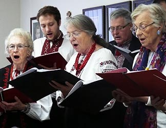 Members of St. Nicholas Ukrainian Catholic Parish sing carols for Bishop David Motiuk.