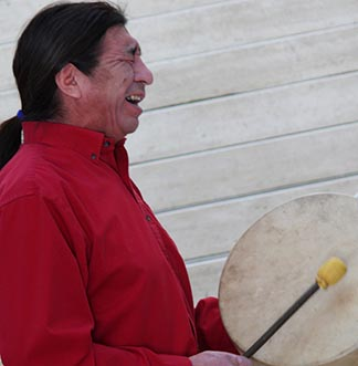Rueben Quinn sings a Cree song during the Jan. 17 opening of a display at Edmonton City Hall marking the Week of Prayer for Christian Unity.