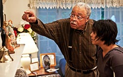 James Earl Jones and Vanessa Hudgens star in a scene from the movie Gimme Shelter.