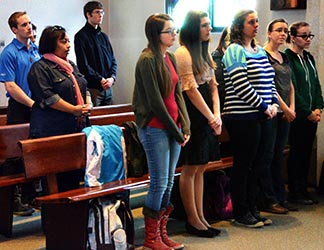 Students attending a weekday Mass at St. Joseph's College of the University of Alberta. However, one out of two young adults raised in the Catholic faith no longer attend church.