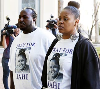 Nailah Winkfield, right, mother of 13 year-old Jahi McMath, who doctors declared brain dead, and Martin Winkfield, the stepfather, arrive at a courthouse in Oakland, Calif., Jan 3.