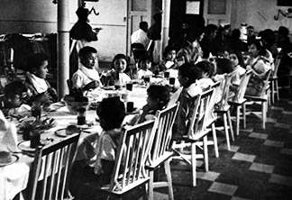 While students in this photo taken at St. Mary's Residential School in Cardston appear well feed, poor government funding was a constant barrier to meeting the dietary and other needs of residential school students.
