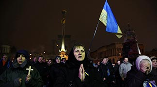 Pro-European Union protesters pray during a rally on Independence Square in Kyiv, Ukraine, early Jan. 16. Canada's Catholic bishops wrote to the head of the Ukrainian Catholic Church, Archbishop Sviatoslav Shevchuk last month assuring him of their prayers and solidarity.