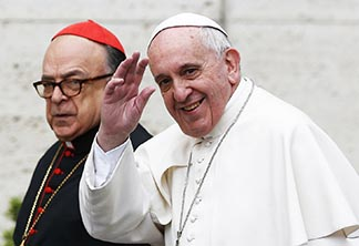 Pope Francis greets journalists as he arrives with Brazilian Cardinal Raymundo Damasceno Assis for a meeting of Cardinals at the Vatican Feb. 20.