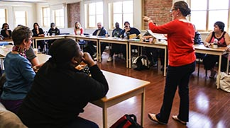 Dr. Tara Hyland-Russell teaches a class in the Humanities 101 program at St. Mary's University College in Calgary.