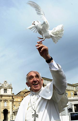 Pope Francis holds a dove in St. Peter's Square at the Vatican last May 15.