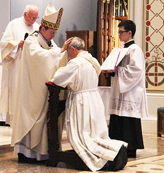 Vancouver Archbishop Michael Miller ordains Michael Shier a Catholic priest, March 15.