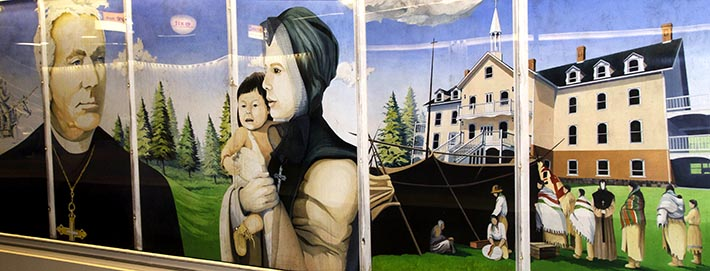 The mural by Sophie Nadeau showing the Venerable Bishop Vital Grandin and a Grey Nun. Some believed Nadeau's mural glorified Indian residential schools.