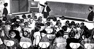 Students in an Edmonton Catholic school watch a French-language TV program in 1962.