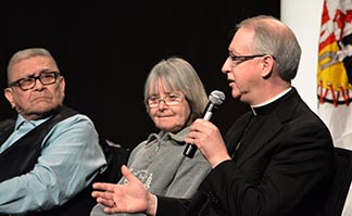 Archbishop Richard Smith speaks on a panel at the Truth and Reconciliation Commission March 28. Listening are Chief Robert Joseph, hereditary chief of the Gwawaenuk First Nation, and Edmonton artist Sylvie Nadeau.