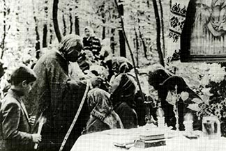 A priest distributes Communion during a clandestine Mass reportedly celebrated in a forest in Ukraine in 1987 under severe communist persecution of the Ukrainian Catholic Church.