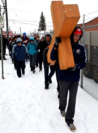 Archbishop O'Leary High School students led the way during most of the Way of the Cross.
