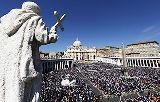 Pope Francis celebrates Easter Mass with at least 150,000 people in St. Peter's Square at the Vatican April 20.