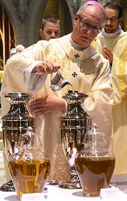 Archbishop Richard Smith prepares the three sacred oils.