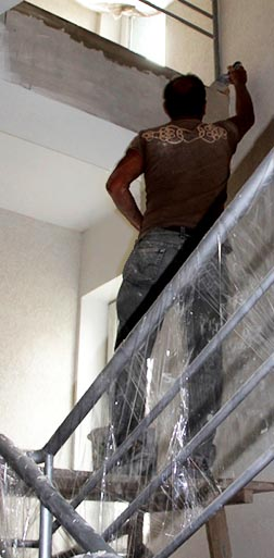 A painter paints a stairwell in Home of Hope in Lyiv, Ukraine.