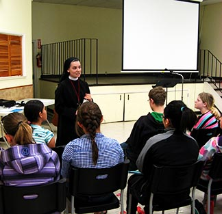Sr. Maria Therese of the Congregation of the Sisters of Merciful Jesus leads a Confirmation retreat for children from Stettler, Bashaw and Castor.