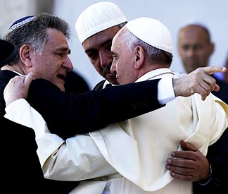 "Pope Francis embraces Argentine Rabbi Abraham Skorka after praying at the Western Wall in Jerusalem May 26. Looking on is Omar Abboud, Muslim leader from Argentina. "" We did it,"" Rabbi Skorka said he told the pope and Abboud."