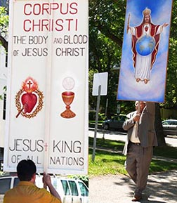Several people carried banners praising Christ's presence in the Eucharist