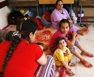 A Christian family who fled from the violence in Mosu rests inb a sheloter in Irbil, Iraq.