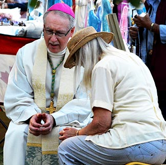 Archbishop Richard Smith heard Confessions before the Aug. 14 pilgrimage Mass.