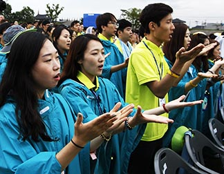 Young people pray as Pope Francis celebrates the closing Mass of the Asian Youth Day in Haemi, South Korea, Aug. 17.