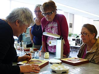 Gisele Bauche (left) leads some of the participants in a 5-day workshop at Providence Renewal Centre in the process of writing an icon of the Mother of God.