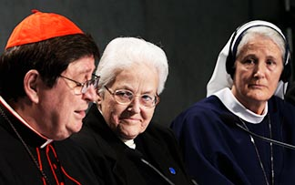 Brazilian Cardinal Joao Braz de Aviz, prefect of the Congregation for Institutes of Consecrated Life and Societies of Apostolic Life, speaks as Sr. Sharon Holland, president of the Leadership Conference of Women Religious, and Sr. Agnes Mary Donovan, coordinator of the Council of Major Superiors of Women Religious, listen during a Dec. 16 Vatican press conference.