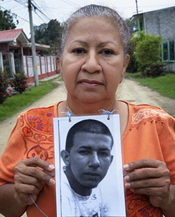 Vilma Maldonado of La Lima, Honduras, holds a photo of her son, Jesus Humberto Sanchez Maldonado. The young man left for the United States in 2010, but Maldonado hasn't heard from him since he last called home in 2011 from the northern Mexican city of Monterrey