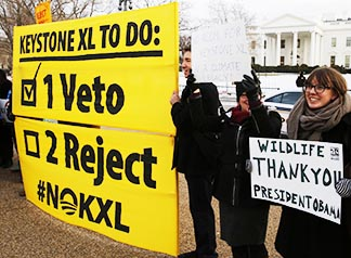 Opponents of the Keystone XL oil pipeline rally in front of the White House Feb. 24, the same day U.S. President Barack Obama vetoed a bill to approve construction of the pipeline.