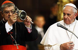 Cardinal Crescenzio Sepe, holding a reliquary containing the blood of St. Januarius, said the dried blood of the saint had begun to liquefy after Pope Francis handled the reliquary.