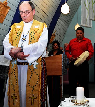 Aboriginal drummer Lyndon Aginas of the Alexis Reserve (right) leads a prayer May 20 while Archbishop Sylvain Lavoie and others listen.