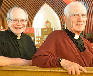 Frs. Robert Kasun and Jack Gallagher in Edmonton's St. Alphonsus Church, one of two churches on 118th Avenue their Basilian order has administered since 2009.