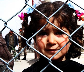 A displaced Syrian girl finds temporary shjelter at a school in Damascus, Syria