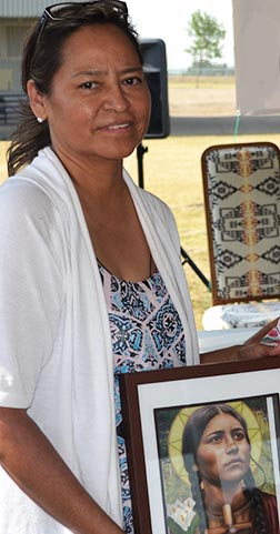Karen Wildcat, organizer of the second annual St. Kateri Gathering at Maskwacis, holds an image of the celebrated saint.