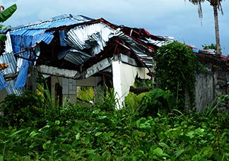 This is  just one of the homes that were destroyed by Typhoon Haiyan and abandoned.