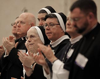 Women religious and clergymen applaud Nov. 16 during the 2015 fall general assembly of the U.S. Conference of Catholic Bishops in Baltimore.