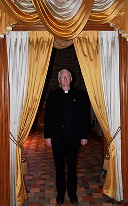 Fr. Martin Carroll, rector of St. Joseph's Basilica, stands in the Holy Door for the Year of Mercy.