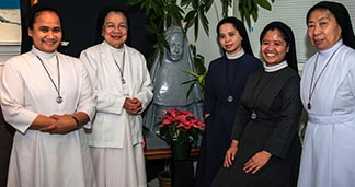 Members of the Religious of the Virgin Mary in their southeast Edmonton convent living room, from left to right: Srs. Maria Jane Alindajao, Maria Cornelia Ramirez, Maria Mara Ubalde, Maria Adrialen Vallecera and Maria Angelita Pascula.