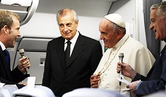 Pope Francis listens to a question from Javier Martinez-Brocal of Rome Reports during a press conference aboard his flight from Asuncion, Paraguay, to Rome on June 12, 2015