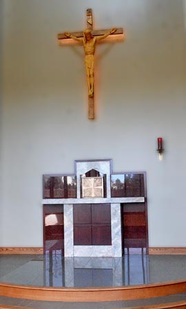 Corpus Christi Church's Blessed Sacrament chapel is located behind the main altar.