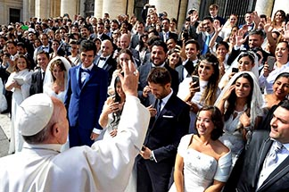 Pope Francis greets newly married couples during his general audience in St. Peter's Square at the Vatican on Sept. 30, 2015