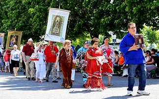 Aboriginal people from the Huron-Wendat First Nation in Quebec City take part in the procession at the Basilica of Ste. Anne-de-Beaupre.