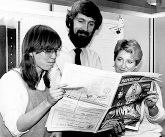 Editor Glen Argan (centre) and reporters Cathy McLaughlin and Lydia Misiewich examine one of the special editions for Pope John Paul II's 1984 visit to Alberta. Argan was not only younger, but hairier, in those days.